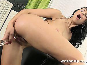 huge-chested Elena Rae pisses thru her stockings