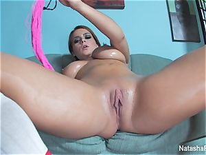 big-chested Natasha lubes up her knockers and plays with her pussy