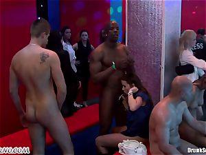 Mass porn hook-up in a striptease bar