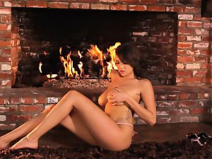 Cassidy Banks playthings her snatch by the fireside