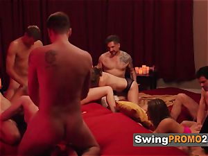 Macho spouse takes his wife out to a nightclub with other swingers