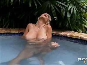 Puma Swede steamy stunner smoking while in the pool