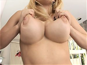 ash-blonde stunner Kagney Karter plays with her humungous milk cans