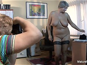 Mature plus-size takes a fountain on her large natural boobs