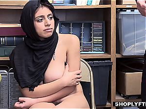 ample titted hijab nubile gets a facial in the shop backoffice